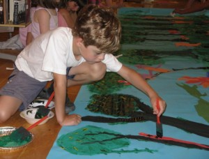 Boy painting during an art workshop