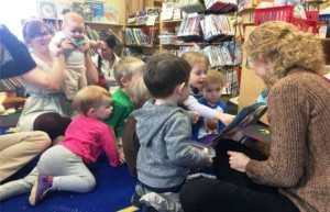 Children listening to a book at library storytime