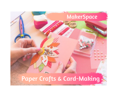 Picture craft materials and hands making a greeting card