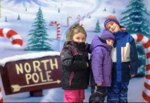 green screen photo of children on road to North Pole