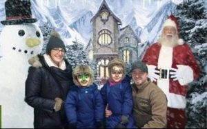 green screen photo of family with Santa and Snowman